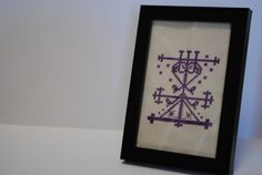 Hey, I found this really awesome Etsy listing at http://www.etsy.com/listing/178812556/maman-brigitte-voodoo-veve-cross-stitch