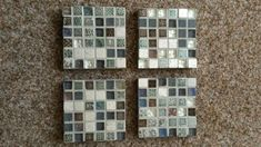 A set of 4 coasters. Made from mosaic tiles. They are in a grey and blue style with Aztec shape within some of them. On sale in etsy for £15 with wendysworkshopGB.
