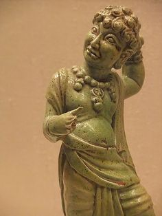Tomb figure of curly-haired man Tang Dynasty 7th-8th century CE China Earthenware with green lead glaze