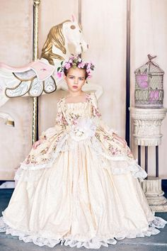 Our Edwardian Rose girls ball gown is a romantic confection of pink, sage, and yellow with a beautiful floral print on a gorgeous yellow background. Can you imagine your sweet little miss making a gra