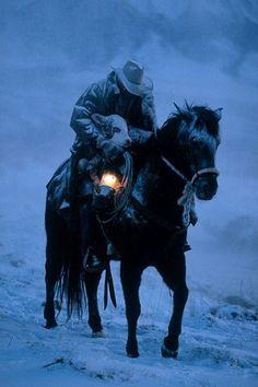 Cowboy Saving Calf.