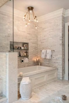 Cream white ceramic tile bathroom with soaker tub: