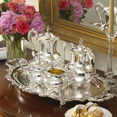 <li>Wallace Royal English coffee and tea service unparalleled in composition<li>Elegant coffee and tea serveware includes coffee pot, tea pot, creamer and sugar pots, and oval tray<li>Coffee and tea set features elegant decorations etched by hand Vintage Silver, Antique Silver, Tee Set, Silver Tea Set, Tea Service, Decoration Table, Online Shopping, Tea Time, Just In Case