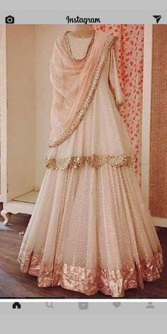 Beautifully draped cream and rose gold lehnga-understated elegance at its best. - Beautifully draped cream and rose gold lehnga-understated elegance at its best. Indian Wedding Outfits, Bridal Outfits, Indian Outfits, Indian Party Wear, Sharara Designs, Lehenga Designs, Pakistani Dress Design, Pakistani Outfits, Pakistani Clothing