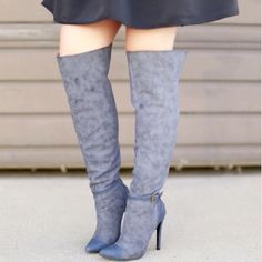 """Blue Faux Suede & Leather Over The Knee Boots New never worn. Color is a light and dark shade of navy. First picture taken outside and other pics taken inside as to why color appears darker compared to first pic. Faux suede and leather material. Back zipper, doesn't zip all the way to the top. Ankle strap. Pointed toe, heel height approx 4.5"""". Circumference at top of boot is 17"""". Minor dark spots/scuffs in some areas, boot arrived as such, but not too noticeable when worn. ❌NO TRADES OR…"""