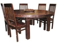 Three inch thick solid wood dining table made in India. The legs are four by fours.  The wood used is all recycled from beams used in old buildings.