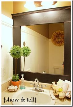 Fixing to do a mini bathroom makeover, using the builder grade mirror, what a fab way to trim out the existing mirror!
