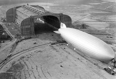 The Hindenburg trundles into the U.S. Navy hangar, its nose hooked to the mobile mooring tower, at Lakehurst, New Jersey, on May 9, 1936. The rigid airship had just set a record for its first north Atlantic crossing, the first leg of ten scheduled round trips between Germany and America.