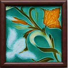 An Art Nouveau teal ground tile, with a stylised iris, bud, and leaf design in pastel blue, burnt orange, and...