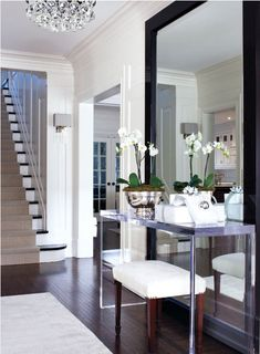 Large floor mirror behind sofa table. Perfect in a foyer - gives the illusion of more space