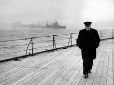 PRIME MINISTER WINSTON CHURCHILL walking the deck of the HMS Prince of Wales, after his first meeting with President Roosevelt during the Atlantic Conference, off of Newfoundland, August 9, 1941.