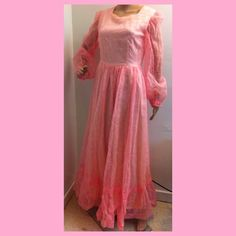 Sweet flocked pink vintage maxi dress. This pink vintage dress has sheer long sleeves with elastic cuffs. Back zipper and lined top to floor ( except sleeves) . Big full skirt with bottom ruffle. Bust 38 waist 30 and length is 58 inches. Vintage Dresses Maxi