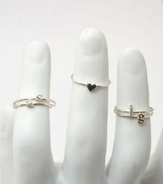 Love the heart ring...so delicate...would also love to get mine, my husband's, and my daughter's initials...Love from catbird