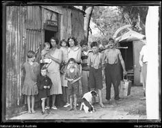 A family standing outside a tin shack called Wiloma during the Great Depression, New South Wales, ca. 1932 [picture].