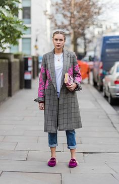 This season it's all about the embroidered coat, as seen on Nina Suess, pictured here outside Julien Macdonald on day two of London Fashion Week. We love how she teams hers with bright magenta Gucci loafers, a casual white tee and cropped denim jeans. Photo: Christian Vierig
