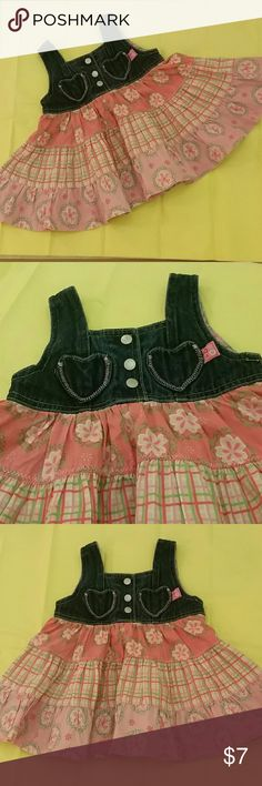 I'm in love with this lovely dress it's so cute to think of your little one rocking this dress. it's a 3 sister style on a balloon cut bottom matched with a denim upper section,makes this dress very beautiful.  It's very girly with its soft color and floral print.. .I'm a country girl, I would have my little on dress up with a cute cowboy boots ..but guaranteed this item is in pristine condition, washed in baby detergent only and ironed ready for shipping. ....prices are reasonable but I do…