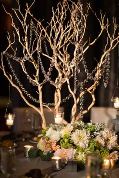 Tall Centerpieces Adorned with Crystals and Candles // Asya Photography // http://www.theknot.com/submit-your-wedding/photo/fab7ed3f-05a6-45b1-b685-548f6b5f4fa9/Brooke-and-David-at-Hotel-Monaco