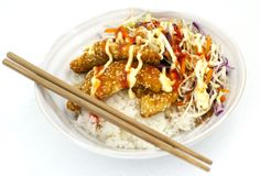 Crunchy chicken and sticky rice with 3 sauces of awesome - chicken tenders coated in rice or corn flour, dipped in beaten egg, then coated in a mix of breadcrumbs (panko or gluten free) and sesame seeds. Serve with rice, coleslaw (shredded green & red cabbage & carrot), and tamari soy sauce, mayonnaise & sweet chilli sauce (the 3 sauces of awesome).