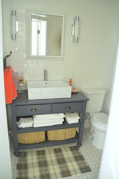 #1905Cottage: Full Bathroom Renovation  I couldn't find a vanity that I liked, so we ended up building one from an inexpensive kitchen island I found. We used a vessel sink and adapted the vanity to accommodate the plumbing, including adjusting the height and rebuilding the drawers.