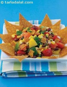 Think Mexican and ingredients like corn, boiled beans and nacho chips immediately pop to your mind. Here is a brilliant Mexican Salad made with these and a lot more interesting ingredients like coloured capsicums and a herby, olive oil based dressing. You will love the interplay of flavours, textures and colours in this creation. While this quick and easy salad is perfect to serve at parties, it must be mixed just before serving to retain the fresh colour and crisp texture of the…