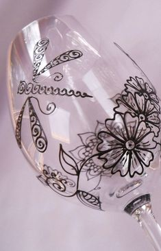 Mehndi Glass Pretty Unique Glassware - the home of custom artisan glassware. Crystal glass.Dishwasher safe. Dragonfly and Henna style designs. Hand painted, one of a kind wine and champagne glasses. Wedding & Giftware. Option to personalize www.mehndiglass.com