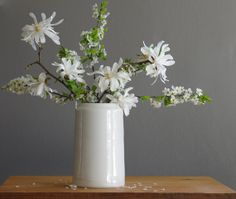 A ceramic jar with modern lines is an easy and elegant way to display cherished blooms.