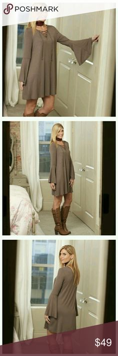 Boho Bell Lace Up Dress This dress is the perfect mix of flirty and casual. Soft knit non clingy fabric, cute lace up detail and just the right amount of a bell sleeve to make it fun. Dark taupe in color. Made in the USA. 95% rayon 5% spandex. Small (2/4), Medium (6/8), Large (10/12). Infinity Raine Dresses