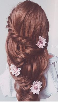 Cascading waterfall braid is a romantic hairstyle for brides. This hairstyle will complete your look and transform you into a princess on your wedding day.
