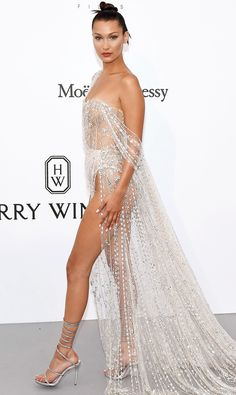 BELLA HADID - After traveling to Rome with Bulgari, Bella returns to Cannes for the amfAR gala and clearly saves her sexiest gown for last in this sheer Ralph & Russo Couture design embroidered with crystals, glass beads and silver chain. - 2017 Cannes Film Festival