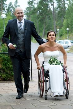 Beautiful wheelchair bride and her groom.  >>> See it. Believe it. Do it. Watch thousands of spinal cord injury videos at SPINALpedia.com