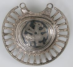 Temple Pendant with Filigree Border Date: 11th–12th century Geography: Made in Kiev Culture: Kievan Rus' Medium: Silver, niello Dimensions: Overall: 2 3/8 x 2 3/16 x 9/16 in. (6 x 5.6 x 1.5 cm)