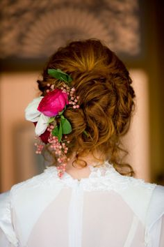 Pretty curly updo with trailing side flowers ~ we ❤ this! moncheribridals.com