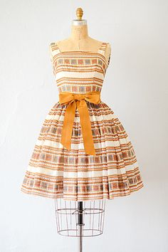 vintage 1960s stamp print sashed party dress