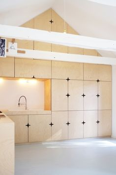 Star motif cut out of doors to serve as handles - designed by Modal Architecture