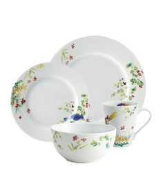 This dinnerware collection is a taste of country charm with a cheerful design of flowers and birds on crisp, white porcelain.