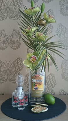 Imitation design i did by recycling a tequila bottle. THE FLORAL EMPORIUM. SOLD