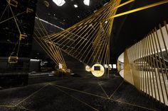 The design element uses black and gold as the main colors, with the dramatic lightings and the radiation lines / continuous lines that represent explosions, to communicate ideas, guidance, and rhythm.
