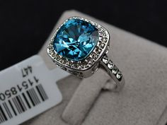'Size 6.5, 7.5, 8 18K WGP Swarovski Crystal Ring' is going up for auction at  7pm Mon, Jan 14 with a starting bid of $1.
