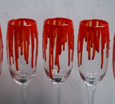 Dripping Blood - An exclusive design, hand painted, Champagne glass featuring 'blood' dripping down the sides! Horror/ Zombie/ Vampire/ Gore by StarlightAndShadows on Etsy https://www.etsy.com/listing/213033551/dripping-blood-an-exclusive-design-hand