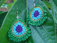 Ravelry: Simple Peacock Earrings pattern by Charlotte W.  Free crochet pattern to make these beautiful Peacock Feather earring from embroidery cotton and a few jewellery findings!  They're lovely!