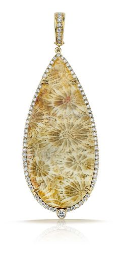 Pamela Huizenga gold pendant with 43.51ct of fossilzed coral outlined in a diamond pavé