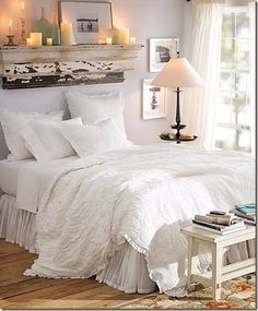 I love this idea of putting a shelve above the bed. it brings so much life onto the wall. There is so much going on above the bed that you don't even need a headboard...and I love the candles