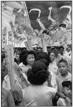 """Henri Cartier-Bresson // China, 1949 -- Shanghai. Communist parade. The banner proclaims: """"Against bureaucratic Capitalism, Feudalism, and Imperialism."""""""