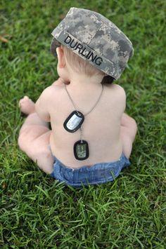 A Baby, dog tags and cap.  Military Brat through and through - MilitaryAvenue.com
