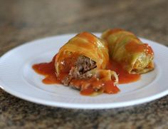This is a popular 5-star recipe for cabbage rolls with ground beef and rice. The sauce is a simple mixture of tomato sauce, tomatoes, and seasonings.