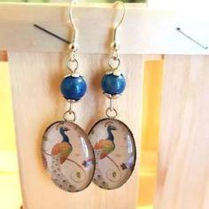 Boucles d'oreilles cabochons paon et perles bleues