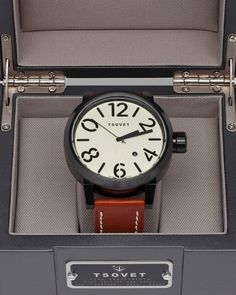 Extra large, round metal face watch from TSOVET with thick, tanned leather band