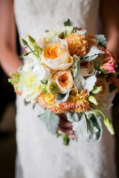 Peach #bouquet with soft greens   Photography: Chris Humphreys Photography  Read More: http://www.stylemepretty.com/little-black-book-blog/2014/05/09/rustic-vail-square-wedding/