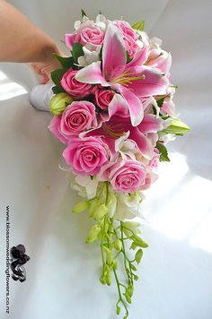 I want purple blue and white but I love the drape and the green buds. Can I do this shape with hand-tie? No bouquet holder?