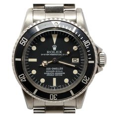 "1stdibs | ROLEX Stainless Steel Sea-Dweller Rail Dial so-called ""Great White"" circa 1978Rolex stainless steel Seadweller so-called ""Great White"", Ref. 1665, serial 5.7 million, circa 1978, with matte black original Rail Dial with light ivory-colored luminous indexes and matching hands. Calibre 1570 self-winding movement with sweep seconds and date. With Rolex stainless steel 93150 heavy Oyster bracelet with flip lock clasp and 580 end-pieces.  Stk# 39293"